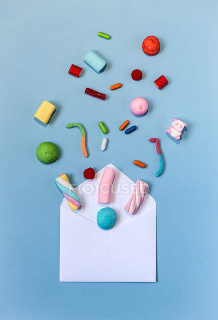 Candies and opened envelope — Stock Photo