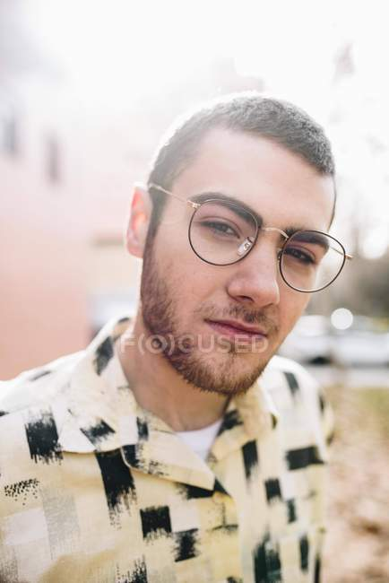 Portrait of stylish man in eyeglasses looking at camera — Stock Photo