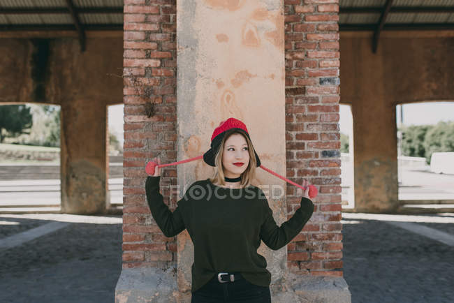 Girl in knitted hat looking aside — Stock Photo