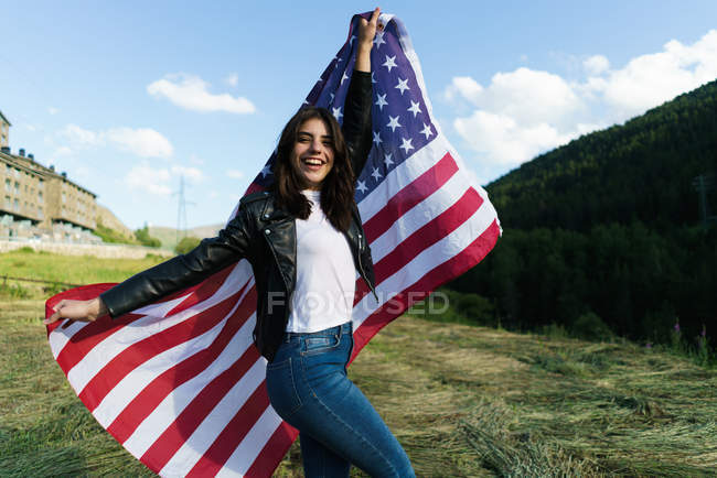 Happy brunette woman posing with USA flag — Stock Photo