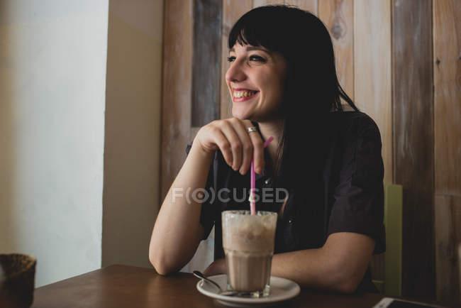 Woman drinking milk shake — Stock Photo