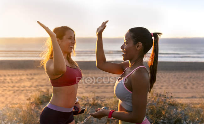 Fitness women giving high five after training — Stock Photo