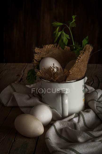 Idyllic still life of eggs and rural mug — Stock Photo