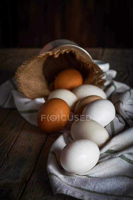Still life of chicken eggs on rural towel — Stock Photo
