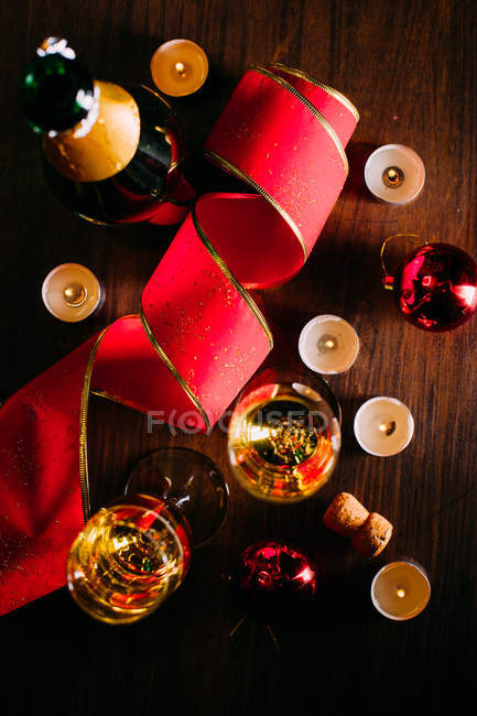 Glasses of champagne with candles — Stock Photo