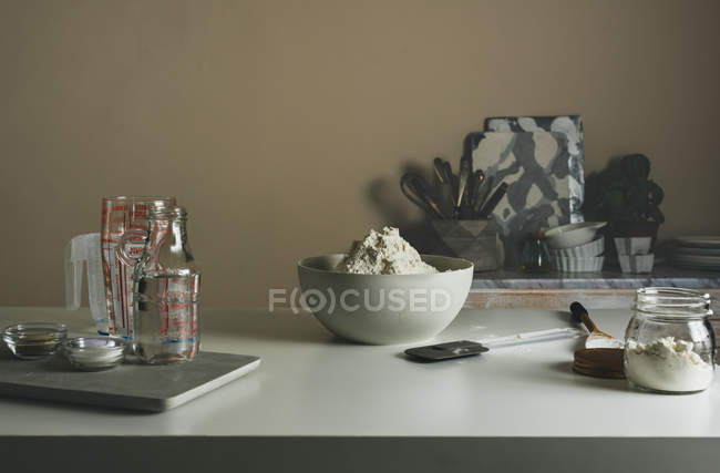 Bread ingridients on kitchen table — Stock Photo