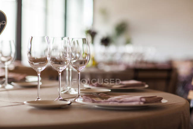 Served table with glasses and plates — Stock Photo