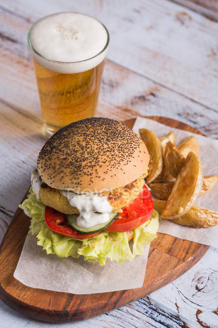 Vegetarian burger and glass of beer — Stock Photo