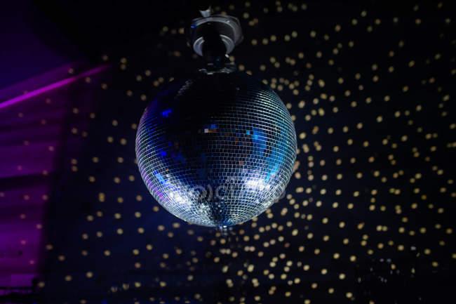 Disco ball over dark wall — Stock Photo