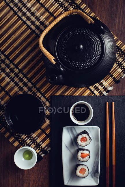Served sushi and tea sets — Stock Photo