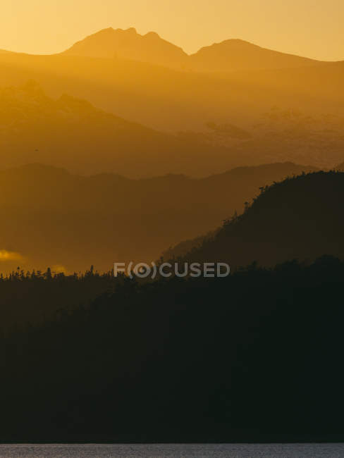 Shades of mountains ridges in sunset — Stock Photo