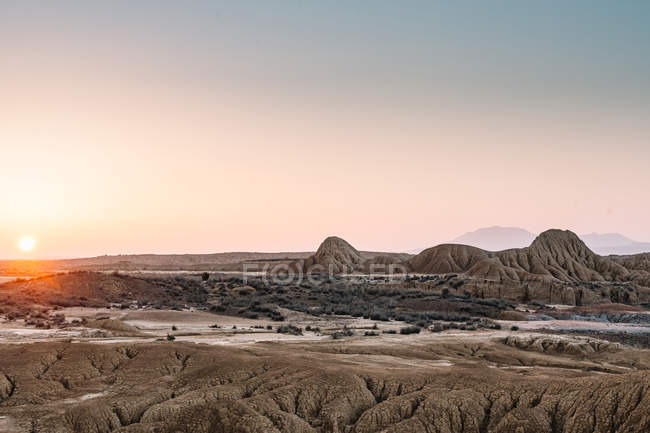 Beautiful View Of Ground Rocky Formation On Background Of Clear Sky