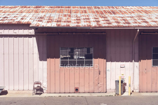 Exterior view of siding panels of storage house. — Stock Photo
