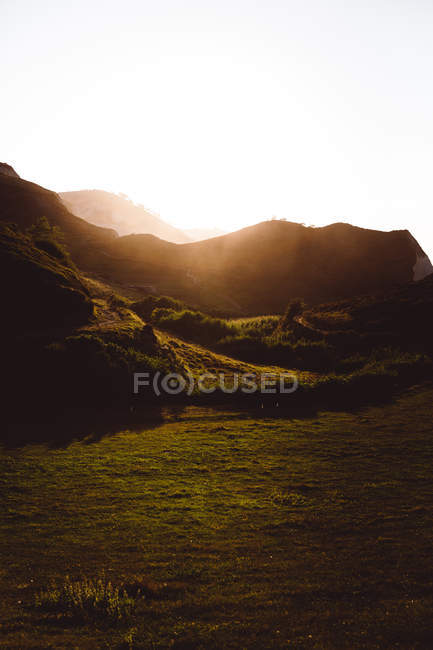 Scenic view of sunlit hills at countryside — Stock Photo