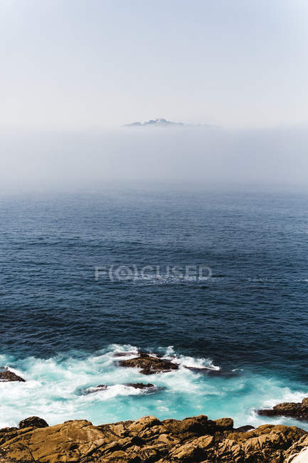 Scenic marine of misty bay with plumb shoreline — Stock Photo