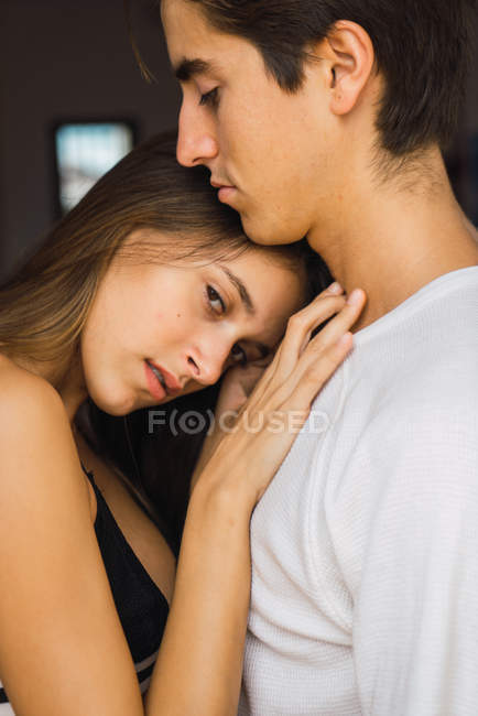 Portrait of young couple embracing sensually — Stock Photo