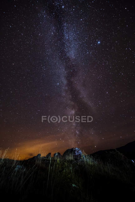 Landscape with mountains and milky way in night sky — Stock Photo