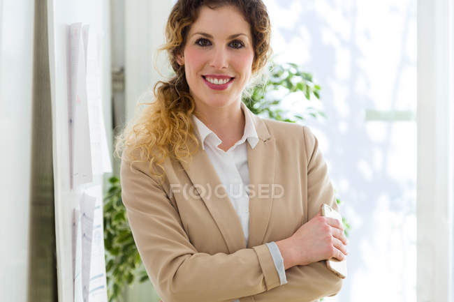 Portrait of  young businesswoman looking at camera. — Stock Photo