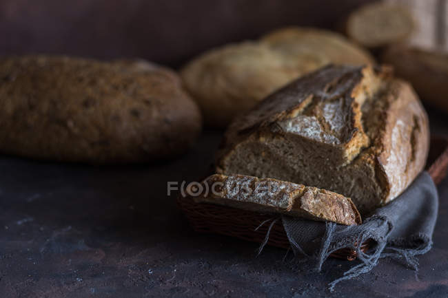 Still life of various home-made bread loafs on table. — Stock Photo