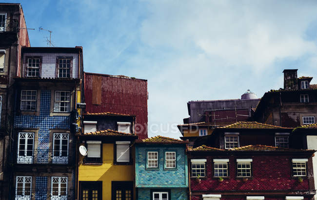 Exterior of bright houses facades at street — copy space, colorful