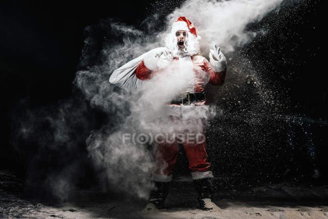 Санта-Клауса вражені сніг бризки — стокове фото