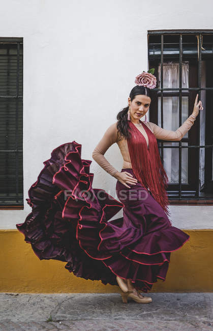 Flamenco dancer wearing typical costume posing over building exterior — Stock Photo