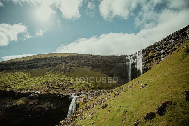 Scenic landscape of waterfall in green valley — Stock Photo