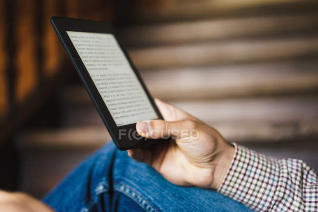 Crop male hand with electronic book tablet — Stock Photo