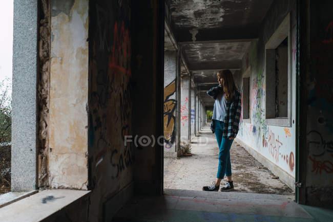 Brunette girl posing in derelict building — Stock Photo