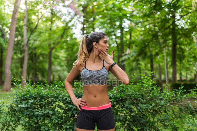 Portrait of athletic girl warming up neck before workout — Stock Photo