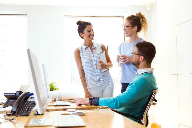Portrait of smiling business people at workplace in modern office. — Stock Photo