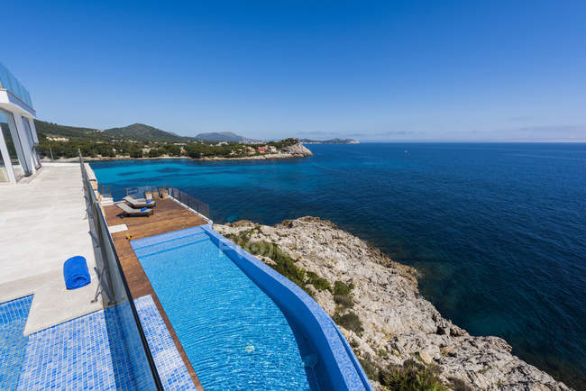 Resort terrace with pool over coastal seascape — Stock Photo