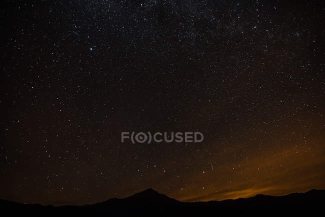 Landscape with mountains and stars in night sky — Stock Photo