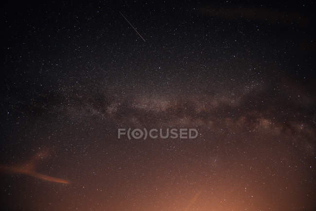 View to starry night sky with shiny stars and milky way — Stock Photo