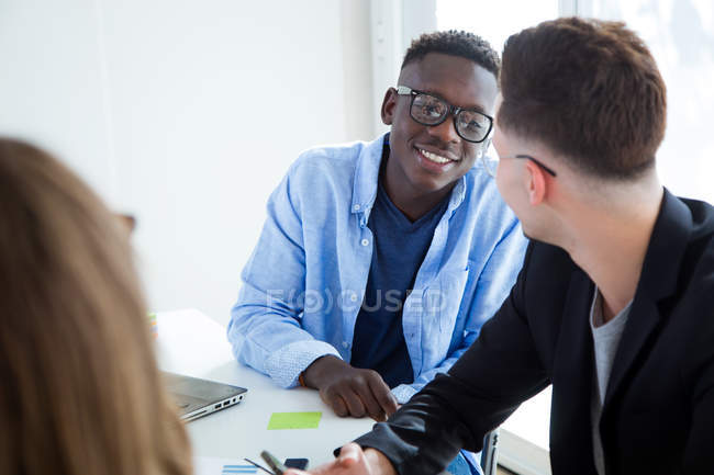 Portrait of business people at meeting in modern office. — Stock Photo