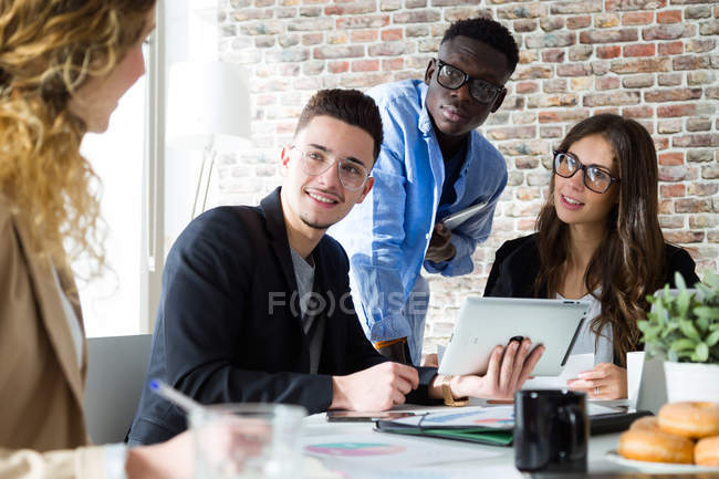 Group of business people at meeting in modern office. — Stock Photo