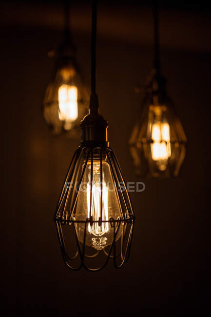 Close up view of modern creative light bulbs on dark background — Stock Photo
