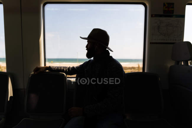Silhouette of person in train sitting by train window — Stock Photo