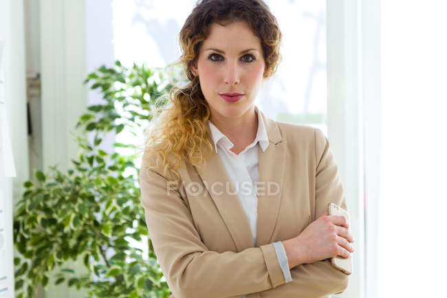 Portrait of  blonde businesswoman looking at camera. — Stock Photo