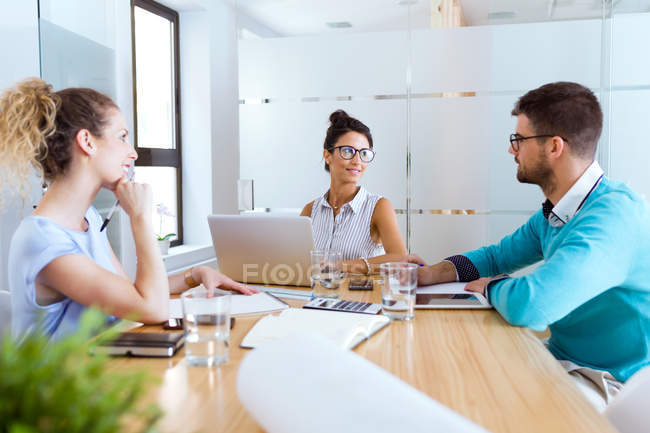 Portrait of group of business people at meeting in modern office. — Stock Photo