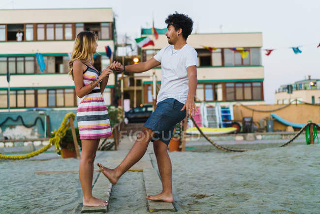 Side view of happy couple having fun on beach — Stock Photo