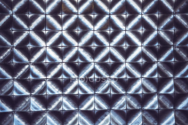 Dark geometric pattern composed of square plates — Stock Photo