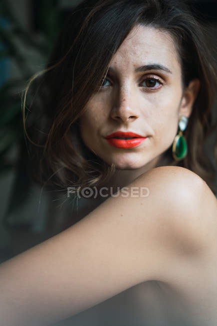 Portrait of brunette woman with bright makeup looking at camera — Stock Photo