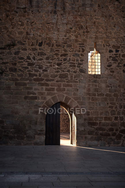 Interior view to castle wall with opened entrance — Stock Photo