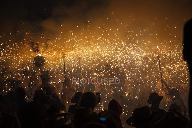 Firework splashes over people at fire game event, Catalonia, Spain — Stock Photo