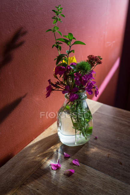 Bunch of wild flowers in vase — Stock Photo