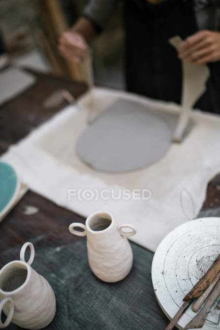 High angle view of artisan working process in pottery studio — Stock Photo