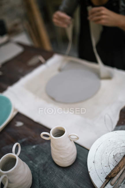 High angle view of artisan working process on table in pottery studio — Stock Photo