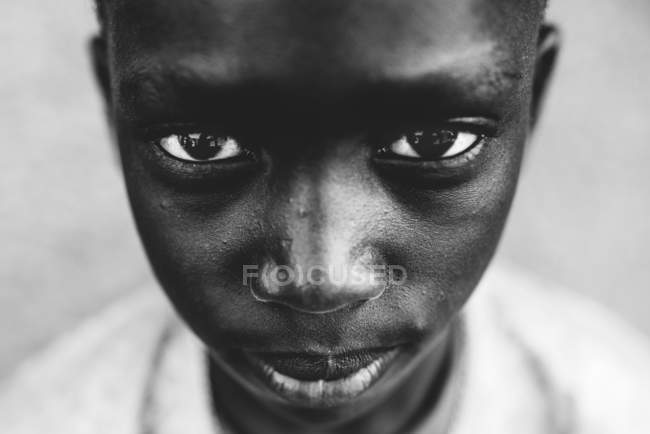 Goree, Senegal - December 6, 2017: Portrait of serious black boy looking at camera . — стоковое фото
