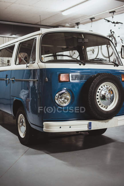 Vintage van in good condition parked in garage — Stock Photo